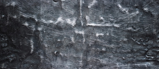Black metal texture, grunge steel background. Crumpled iron surface of panoramic view
