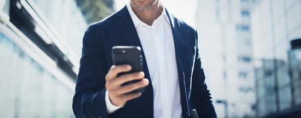Fototapeta Businessman with smartphone obraz