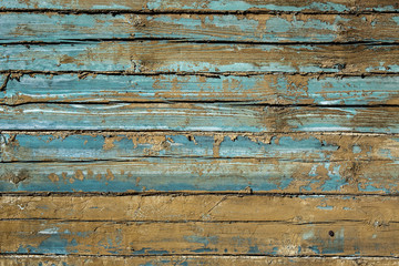 Aged cracked wooden boards background, blue vintage ligneous texture. Retro wood surface backdrop