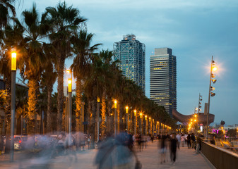 Illuminated quay in Barcelona with blurred people