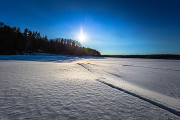 Falun - March 31, 2018: Panorama of the frozen lake of Framby Udde near the town of Falun in Dalarna, Sweden