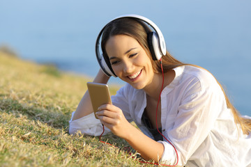 Girl listening to music watching smart phone content