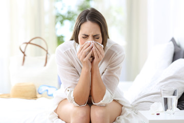 Ill woman coughing in an hotel on vacations