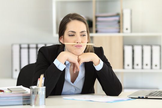 Lazy employee wasting time at office