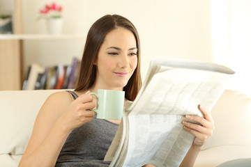 Woman reading a newaspaper in the morning