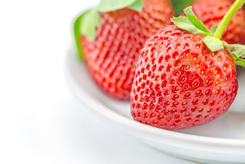 fresh strawberries on plate on white background