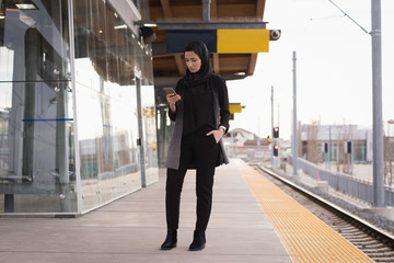 Woman in hijab using mobile phone