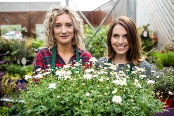 Female florists standing together at garden center