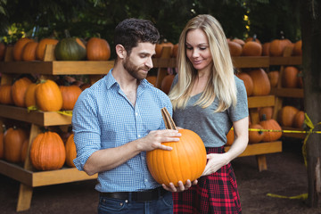 Couple holding pumpkin