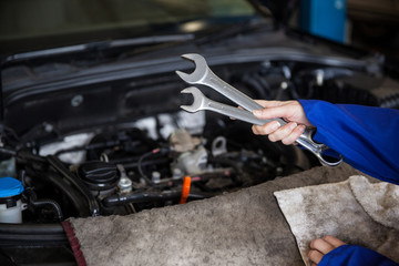 Mechanic servicing car engine