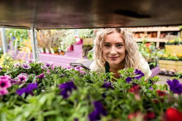 Smiling female florist in garden center