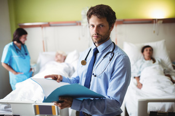 Portrait of doctor checking report