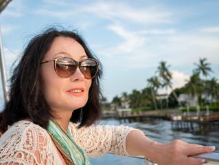 Close-up portrait of a beautiful senior woman in sunglasses