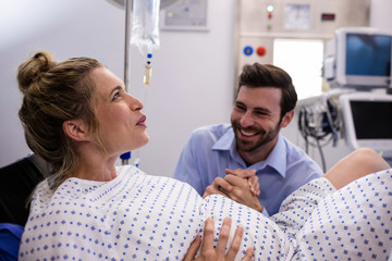 Man comforting pregnant woman during labor