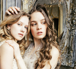 two pretty twin sister blond curly hairstyle girl in luxury hous