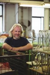 Portrait of smiling glassblower