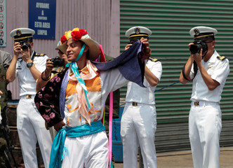 Members of Taiwan's navy take photos of a dancer as they participate in joint training and military activities with the Nicaraguan Navy at Corinto port