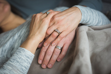 Couple holding hands in living room