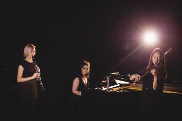 Women playing various instrument