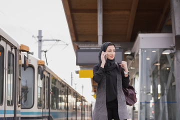 Woman in hijab talking on mobile phone