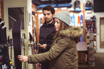Couple selecting ski in a shop