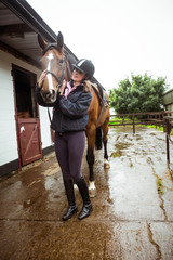 Pretty woman hugging her horse