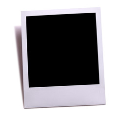 Blank instant camera photo print isolated on white