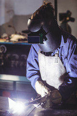 Female welder working on a piece of metal