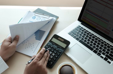 Close up businessman using calculator on documents Unrecognizable finance  use calculate about cost at office