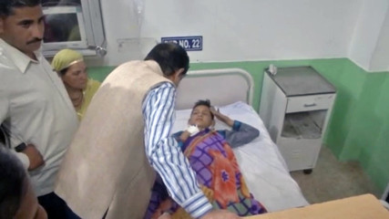 An injured passenger of a school bus that fell into a gorge lies on a hospital bed in Himachal Pradesh
