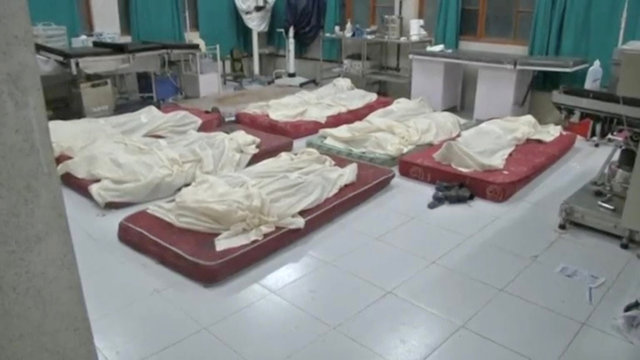 Covered bodies of passengers of a school bus that fell into a gorge are pictured at a hospital in Himachal Pradesh