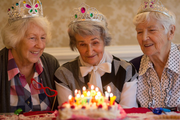Senior woman celebrating birthday with her friends