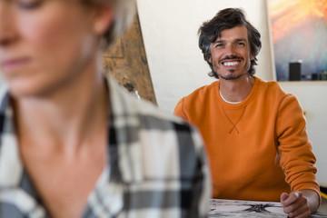 Portrait of smiling man in art class