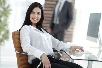successful young business woman sitting at workplace