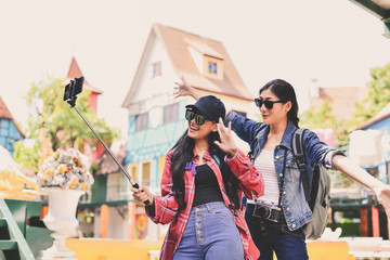 Tourists are taking photos in the city.