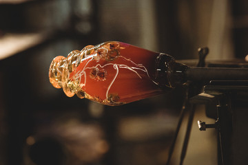 Close-up of molten glass on a blowpipe