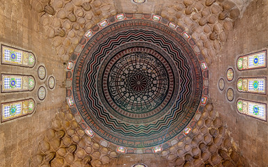 Colorful decorated painted dome, Ceiling of Al Zaher Barquq mausoleum with stained glass windows, Old Cairo, Egypt