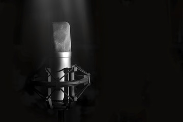 Studio microphone for singer on a black background