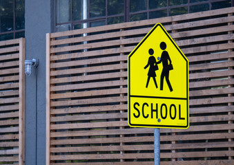 School zone warning sign posted on street