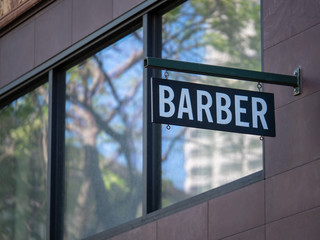 Modern Barber sign hanging outside the shop