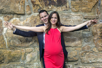 Pregnant couple spreaded arms