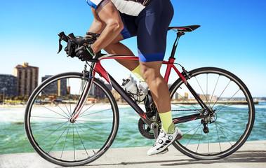 side view race biker on pier