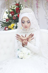 indonesian hijab girl with henna tattoo on the hands