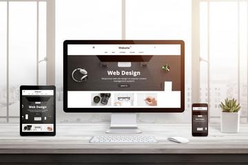 Web site studio presentation on responsive display devices. Modern studio interior. White wooden desk. Window and sun light in background.