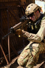 Airsoft player, soldier with weapon