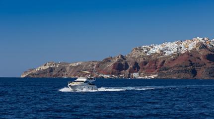 Boat in deep blue water, Santorini, Greece.