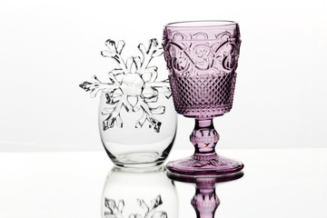 Different empty glasses against white background