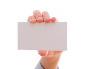 Child's hand showing an empty business card