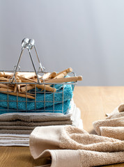 towels with wooden clothing pins for laundry and hygiene concept
