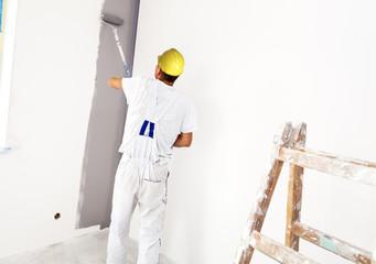 House painter paints the interior. Unrecognizable Person.